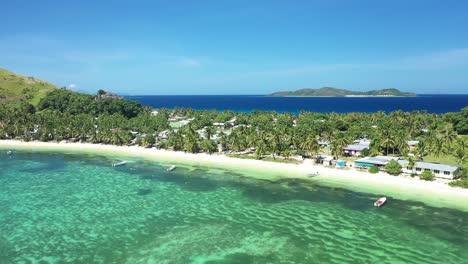 An-Aerial-View-Shows-Boats-Docked-On-The-Beach-Of-Yanuya-Island-Fiji-1