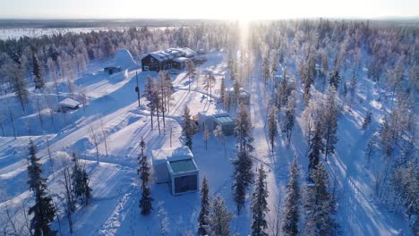 An-Aerial-View-Shows-Trees-And-Lodgings-Of-The-Snowcovered-Northern-Lights-Ranch-In-Kongas-Finland