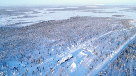 An-Vista-Aérea-View-Shows-Trees-And-Lodgings-Of-The-Snowcovered-Northern-Lights-Ranch-In-Kongas-Finland-2