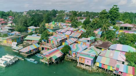 An-Aerial-View-Shows-The-Colorful-Buildings-And-Boats-Of-Rainbow-Village-On-The-Kai-Islands-Indonesia