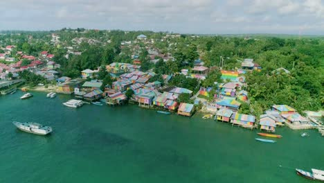 An-Aerial-View-Shows-The-Colorful-Buildings-And-Boats-Of-Rainbow-Village-On-The-Kai-Islands-Indonesia-1