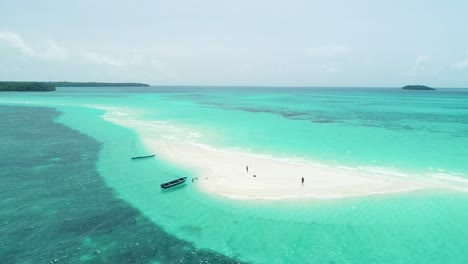 An-Aerial-View-Shows-Boats-And-Tourists-Enjoying-Snake-Island-Indonesia