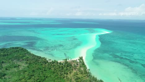 An-Aerial-View-Shows-Palm-Trees-And-The-Serpentine-Sandbank-Of-Snake-Island-Indonesia-2