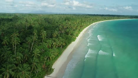 An-Aerial-View-Shows-Waves-Lapping-At-Madwaer-Beach-In-Maluku-Indonesia