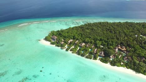 An-Aerial-View-Shows-An-Island-Resort-On-Maldives