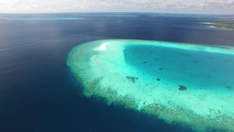 An-Aerial-View-Shows-A-Sand-Island-On-Maldives