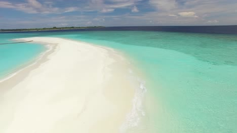 An-Aerial-View-Shows-A-Sand-Island-On-Maldives-1