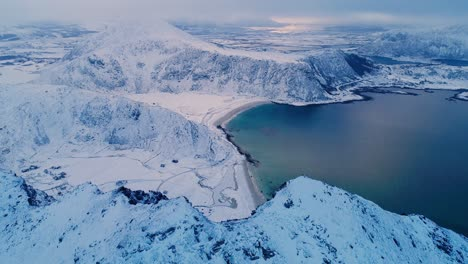 An-Aerial-View-Shows-Wintry-Mountains-Near-The-Coastline-Of-The-Lofoten-Islands-In-Norway