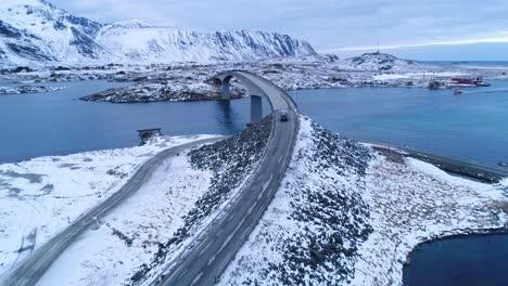 A-Van-Drives-Across-A-Bridge-On-The-Wintry-Lofoten-Islands-Norway