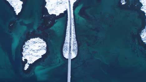 A-Bird-Seyeview-Shows-Cars-Driving-Over-Bridges-Connecting-The-Lofoten-Islands-In-Norway-In-Wintertime