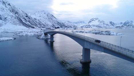 A-Van-Drives-Across-A-Bridge-On-The-Wintry-Lofoten-Islands-Norway-1