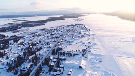 An-Aerial-View-Shows-The-Colorful-Homes-Near-A-Forest-In-The-Wintry-Town-Of-Kiruna-Sweden-1