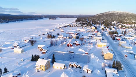 An-Aerial-View-Shows-The-Colorful-Homes-Near-A-Forest-In-The-Wintry-Town-Of-Kiruna-Sweden-2