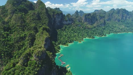 An-Aerial-View-Shows-Green-Mountains-And-Harbor-Lodgings-At-Khao-Sok-National-Park-In-Surat-Thani-Thailand