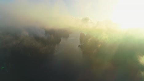 An-Aerial-View-Shows-Khao-Sok-National-Park-In-Surat-Thani-Thailand-Through-The-Haze-Of-Clouds