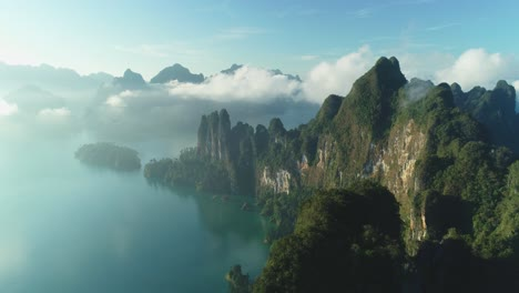 An-Aerial-View-Shows-Green-Mountain-Islands-Of-Khao-Sok-National-Park-In-Surat-Thani-Thailand-Among-Clouds