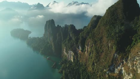 An-Aerial-View-Shows-Green-Mountains-And-Harbor-Lodgings-Among-The-Clouds-At-Khao-Sok-National-Park-In-Surat-Thani-Thailand