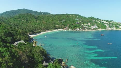 An-Aerial-View-Shows-Tourists-Enjoying-The-Beach-On-Ko-Tao-Thailand