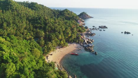 An-Aerial-View-Shows-Tourists-Enjoying-Swimming-And-Swings-On-The-Beach-Of-Ko-Tao-Thailand