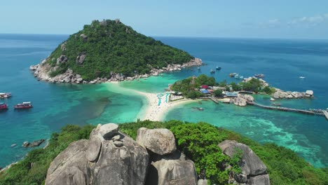 An-Aerial-View-Shows-Boats-Anchored-Near-And-Tourists-Relaxing-On-The-Interconnected-Ko-Tao-Islands-In-Thailand-3