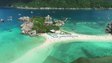 An-Aerial-View-Shows-Tourists-Relaxing-On-The-Beach-Or-Swimming-At-Ko-Tao-Thailand