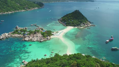 An-Aerial-View-Shows-Tourists-Walking-Along-A-Beach-On-Ko-Tao-Thailand