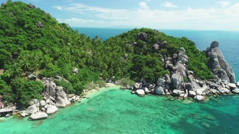 An-Vista-Aérea-View-Shows-Tourists-Exploring-A-Rocky-Harbor-Of-Ko-Tao-Thailand
