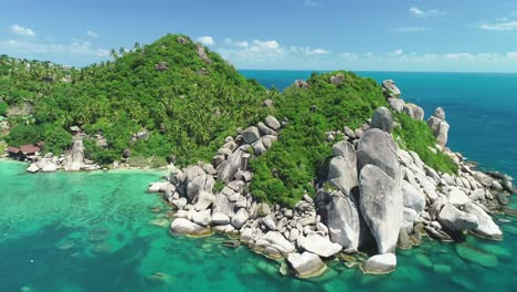 An-Aerial-View-Shows-Palm-Trees-Growing-Among-Rocks-On-Ko-Thao-Thailand