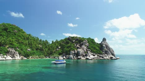 Boats-Are-Seen-Anchored-By-A-Palm-Treelined-Rocky-Coastline-Of-Ko-Tao-Thailand