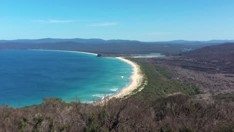 An-Excellent-Aerial-View-Looming-From-A-Forest-To-Disaster-Bay-Lookout-At-Ben-Boyd-National-Park-In-New-South-Wales-Australia