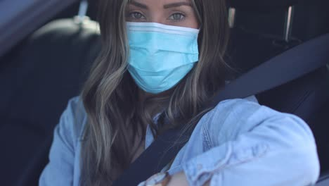 A-cleared-woman-with-mask-shows-ID-at-a-drive-through-test-clinic-during-the-Covid19-coronavirus-pandemic-epidemic