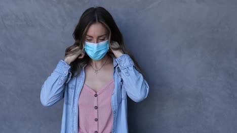 A-cleared-female-nurse-or-woman-with-mask-puts-on-a-mask-during-the-Covid19-coronavirus-pandemic-epidemic-1