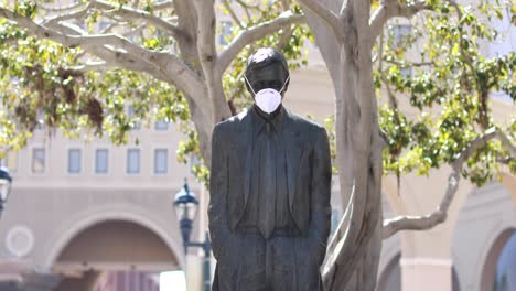 A-statue-in-a-park-wears-a-Covid19-mask-during-the-Covid19-coronavirus-pandemic-epidemic