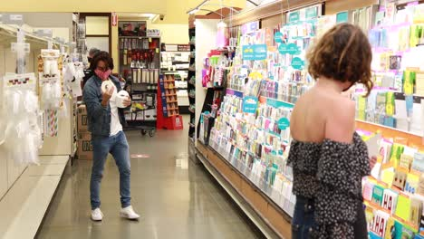 Funny-shot-of-a-man-finding-toilet-paper-TP-in-a-supermarket-during-the-shortage-Covid19-coronavirus-pandemic-epidemic