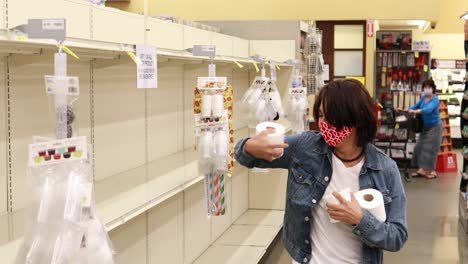 Funny-shot-of-a-man-finding-toilet-paper-TP-in-a-supermarket-during-the-shortage-Covid19-coronavirus-pandemic-epidemic-1
