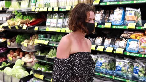 A-woman-in-mask-shops-in-the-produce-section-of-a-supermarket-during-the-Covid19-coronavirus-pandemic-epidemic-2