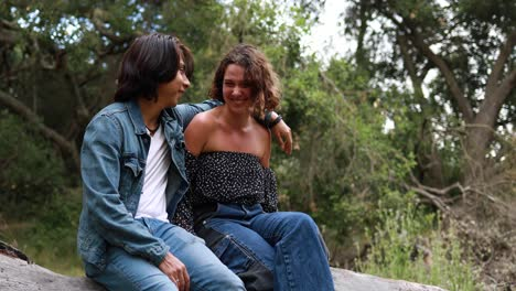 A-Hispanic-couple-sits-in-a-park-laughing-and-enjoying-each-others-company