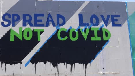 Street-art-urges-people-to-spread-love-not-Covid-during-the-Covid19-coronavirus-pandemic-epidemic