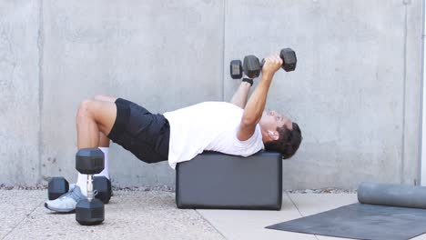 A-man-lifts-weights-and-works-out-during-a-workout-session-at-a-gym