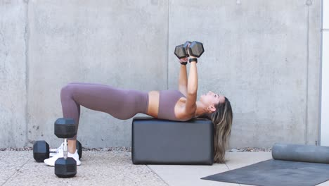 A-woman-lifts-weights-and-works-out-during-a-workout-session-exercise-fitnss-at-a-gym