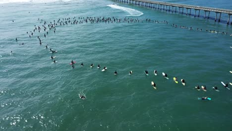 Aerial-over-surfers-in-circle-during-BLM-Black-Lives-Matter-Paddle-For-Freedom-gathering-in-California-6