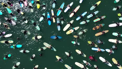 Aerial-over-surfers-in-circle-during-BLM-Black-Lives-Matter-Paddle-For-Freedom-gathering-in-California-8
