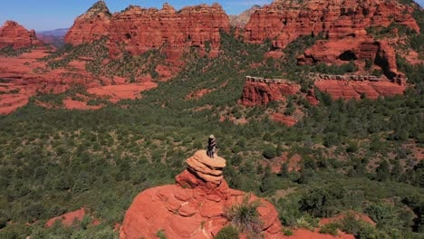 Aerial-of-two-lovers-couple-standing-on-red-peak-butte-near-Sedona-Arizona