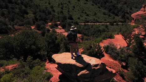 Aerial-of-two-lovers-couple-standing-on-red-peak-butte-near-Sedona-Arizona-1