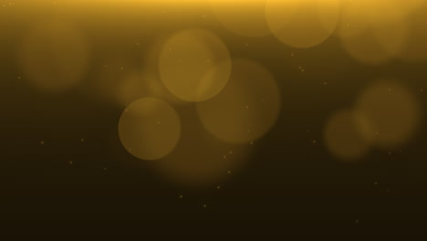 Motion-and-fly-gold-particles-and-round-bokeh-on-dark-animation-background