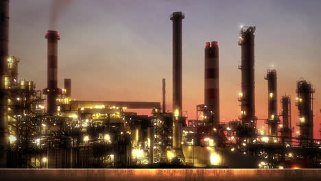 Panorama-of-city-landscape-with-many-big-factory-pipes-in-sunset-summer-day