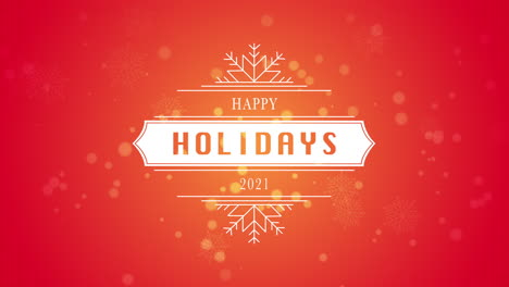 Animated-closeup-Happy-Holidays-and-2021-text-white-snowflake-and-glitter-on-snow-red-background