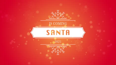 Animated-closeup-Santa-is-Coming-and-2021-text-white-snowflake-and-glitter-on-snow-red-background