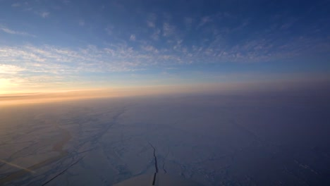 Pov-Shot-From-The-Front-Of-A-Plane-Flying-Over-Frozen-Arctic-Tundra