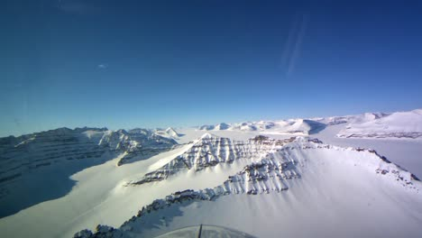Pov-Shot-From-The-Front-Of-A-Plane-Flying-Over-Frozen-Arctic-Tundra-Of-Greenland
